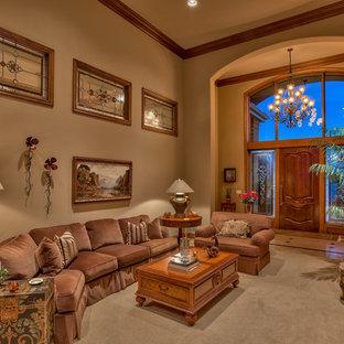オマハの大きいトラディショナルスタイルのおしゃれな独立型リビング (フォーマル、茶色い壁、カーペット敷き、標準型暖炉、石材の暖炉まわり、テレビなし、ベージュの床) の写真