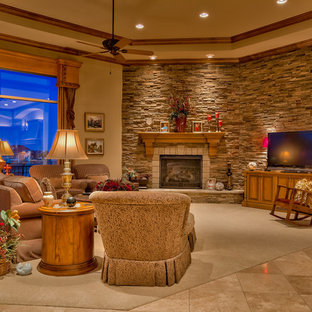 Large classic formal open plan living room in Omaha with brown walls, carpet, a stone fireplace surround, a freestanding tv, a standard fireplace and beige floors.
