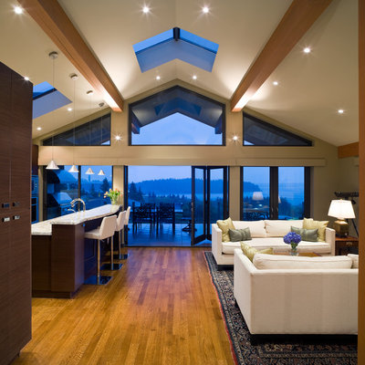 Inspiration for a contemporary open concept medium tone wood floor living room remodel in Vancouver