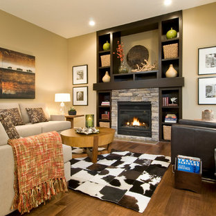 Eclectic living room photo in Calgary with a stone fireplace
