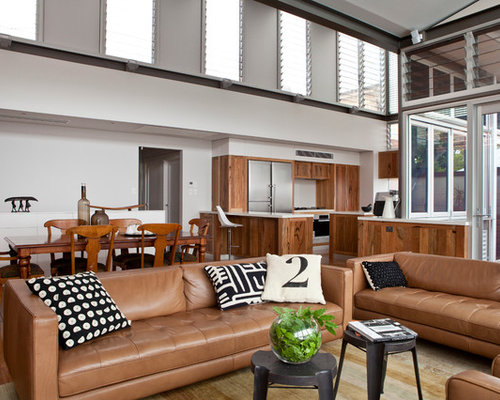 living room leather furniture. Example of a large transitional open concept medium tone wood floor living  room design in Perth Black Leather Sofa Ideas Houzz