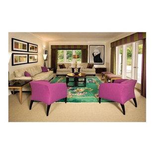 Ispirazione per un grande soggiorno design aperto con pareti verdi, moquette e nessuna TV