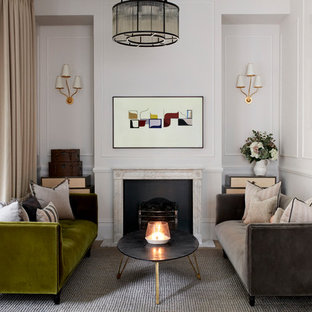 Inspiration for a transitional dark wood floor and brown floor living room remodel in London with white walls and a standard fireplace