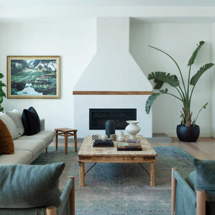 This is an example of a contemporary living room in Perth with white walls, light hardwood floors, a ribbon fireplace and beige floor.