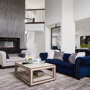 Inspiration for a large contemporary formal open concept living room in Chicago with white walls, dark hardwood floors, a wall-mounted tv, a two-sided fireplace and a stone fireplace surround.