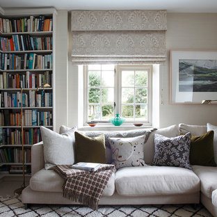 Classic enclosed living room in London with a reading nook and beige walls.