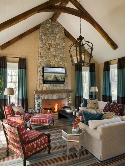 Traditional Living Room Idea In Boston With A Stone Fireplace Surround