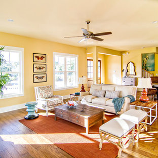 Mid-sized beach style open concept dark wood floor living room photo in Jacksonville with yellow walls and no tv