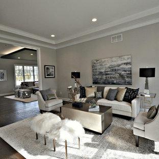 Immagine di un grande soggiorno chic chiuso con sala formale, pareti grigie, parquet scuro, nessuna TV e nessun camino
