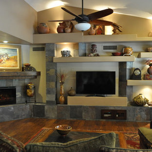 Mid-sized southwest open concept and formal dark wood floor and brown floor living room photo in Phoenix with beige walls, a corner fireplace, a stone fireplace and a tv stand