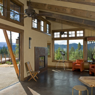 Living room - mid-sized rustic formal and open concept concrete floor living room idea in Seattle with beige walls and no tv