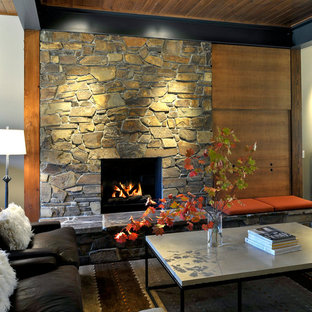 Living room - contemporary open concept living room idea in Seattle with a stone fireplace