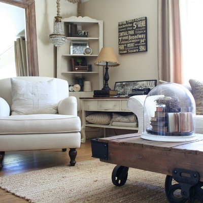 Example of a mid-sized cottage chic formal and open concept vinyl floor living room design in Los Angeles with beige walls and no tv