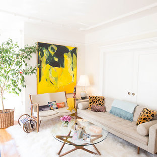 Photo of a small midcentury formal enclosed living room in San Francisco with beige walls and light hardwood flooring.
