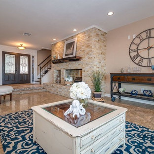 Example of a large coastal open concept travertine floor and beige floor living room design in Orlando with beige walls, a two-sided fireplace, a brick fireplace and no tv