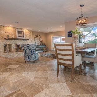 オーランドのビーチスタイルのおしゃれなLDK (ベージュの壁、トラバーチンの床、両方向型暖炉、レンガの暖炉まわり、テレビなし、ベージュの床) の写真