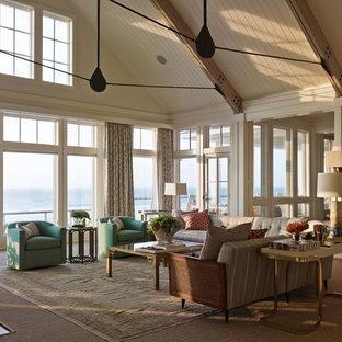 ウィルミントンの大きいビーチスタイルのおしゃれなLDK (フォーマル、白い壁、淡色無垢フローリング、標準型暖炉、石材の暖炉まわり) の写真