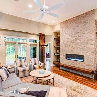 Foto de salón para visitas abierto, de estilo americano, de tamaño medio, sin televisor, con paredes beige, chimenea lineal, suelo marrón, suelo de madera oscura y marco de chimenea de piedra
