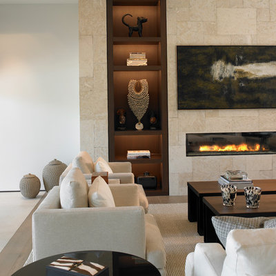 Example of a trendy formal living room design in Miami with beige walls, a ribbon fireplace and a tile fireplace