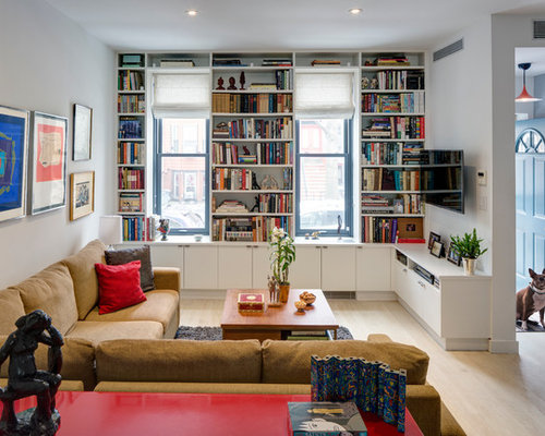 Example Of A Trendy Living Room Design In New York With Library White Walls