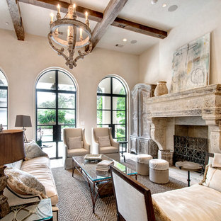 Attrayant Example Of A Tuscan Formal Living Room Design In Houston With A Standard  Fireplace, A