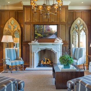 アトランタの大きい地中海スタイルのおしゃれなLDK (フォーマル、茶色い壁、標準型暖炉、壁掛け型テレビ、濃色無垢フローリング、漆喰の暖炉まわり) の写真