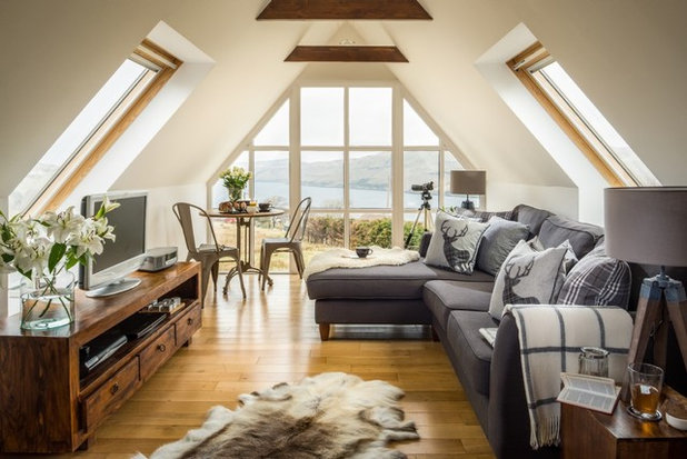 Rustic Living Room by Unique Home Stays