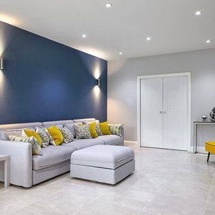 Living room - mid-sized contemporary open concept porcelain floor and white floor living room idea in Surrey with blue walls and a wall-mounted tv