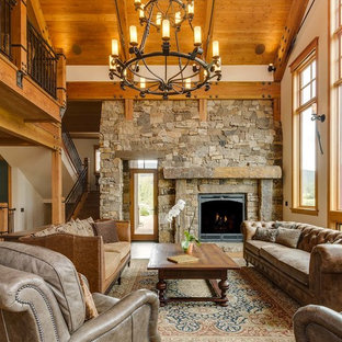 Living room - rustic loft-style medium tone wood floor and brown floor living room idea in Denver with white walls, a standard fireplace and a stone fireplace