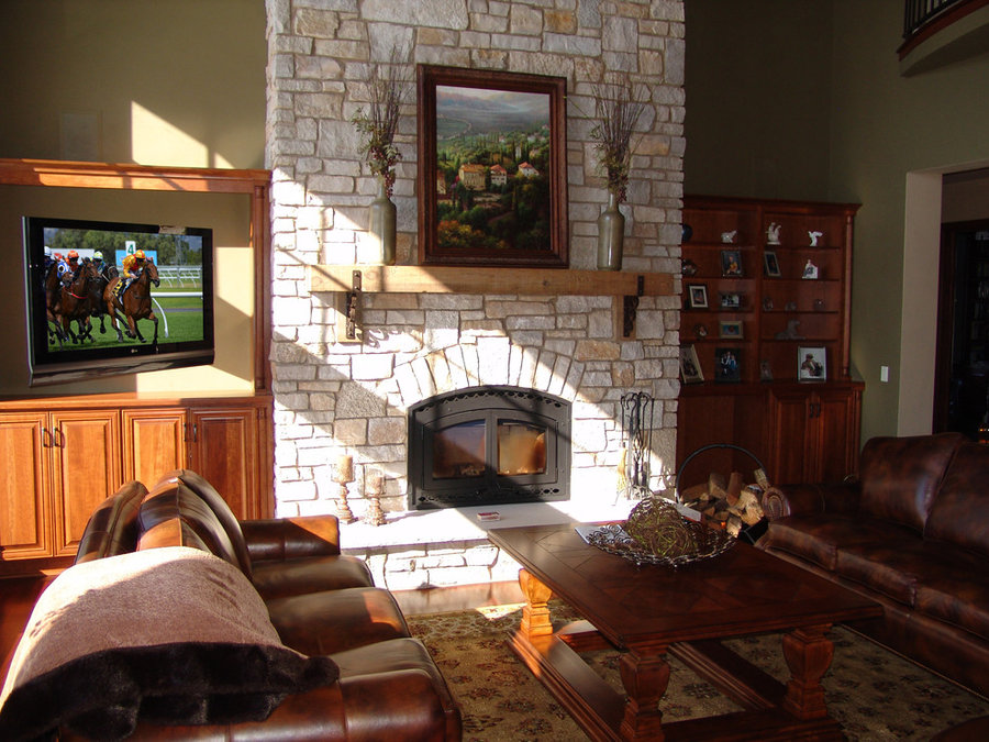 Swivel Mount Television in Cabinet Next to Stone Fireplace