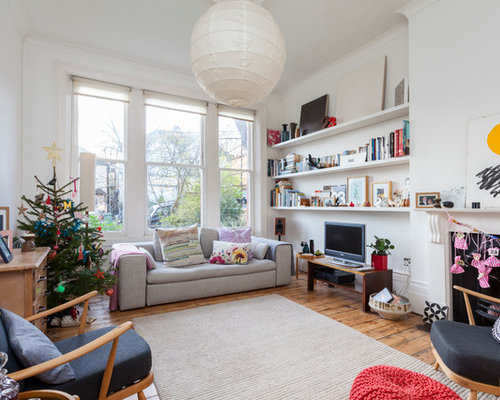 Photo Of A Bohemian Living Room In London With White Walls, Medium Hardwood  Flooring,