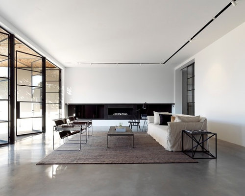 track lighting living room. Example Of A Large Minimalist Formal Concrete Floor Living Room Design In Sydney With White Walls Track Lighting
