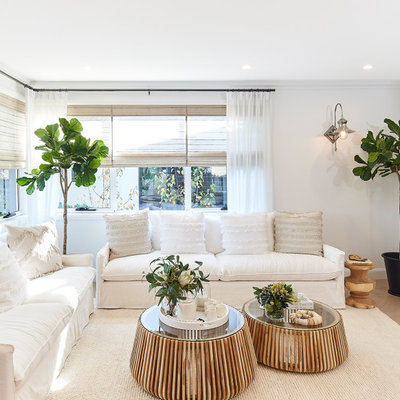 Living room - large transitional open concept beige floor living room idea in Sydney with white walls and a wall-mounted tv