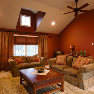 Design ideas for a traditional living room in New York with red walls.