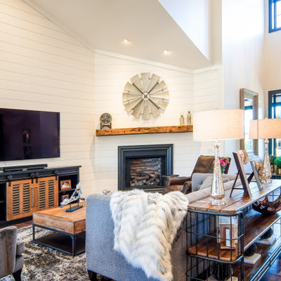 Inspiration for a country medium tone wood floor living room remodel in Cleveland with white walls