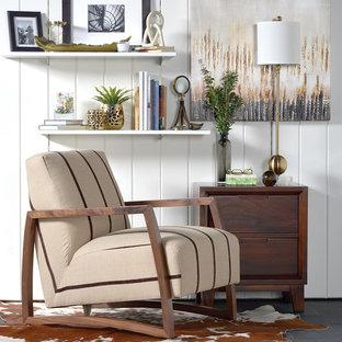 Foto di un piccolo soggiorno moderno chiuso con pareti bianche, pavimento in ardesia, nessun camino e nessuna TV