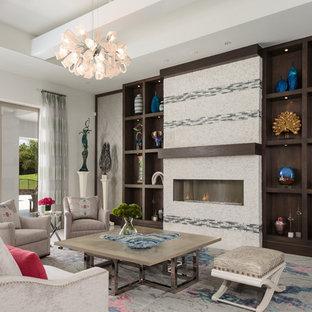 マイアミの巨大なビーチスタイルのおしゃれなLDK (フォーマル、白い壁、大理石の床、横長型暖炉、タイルの暖炉まわり、埋込式メディアウォール、マルチカラーの床) の写真