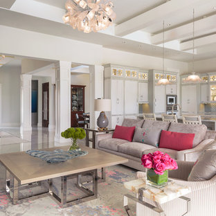 Example of a huge coastal formal and open concept marble floor and multicolored floor living room design in Other with white walls, a ribbon fireplace, a tile fireplace and a media wall