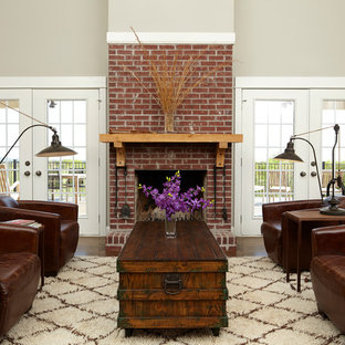 Elegant living room photo in Atlanta with beige walls, a standard fireplace, a brick fireplace and no tv