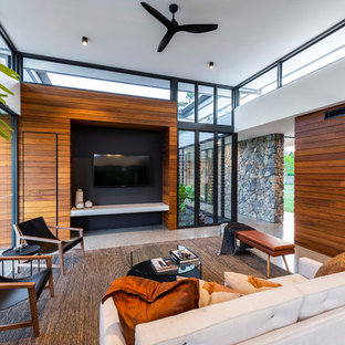 Photo of a contemporary living room in Gold Coast - Tweed with white walls, a wall-mounted tv and grey floor.