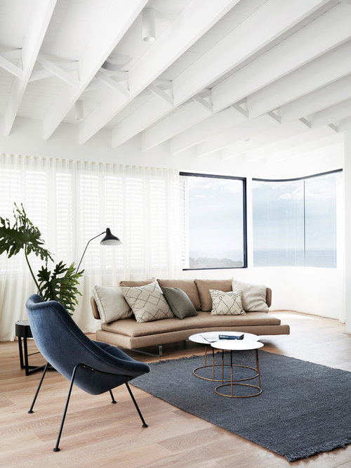 Inspiration For A Modern Formal Enclosed Living Room In Sydney With White  Walls, Medium Hardwood