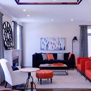 Ejemplo de salón para visitas abierto, actual, grande, sin televisor, con paredes blancas, suelo de madera oscura, chimenea tradicional y marco de chimenea de madera