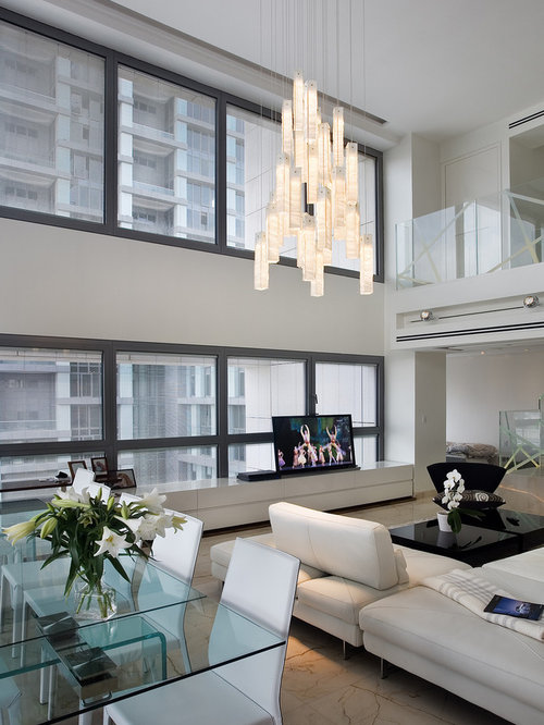 Trendy Living Room Photo In New York With White Walls And A Tv Stand