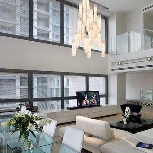 Idee per un soggiorno minimal con pareti bianche e TV autoportante