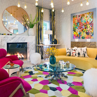 Design ideas for an eclectic formal living room in Los Angeles with no tv, multi-coloured walls, a standard fireplace, a stone fireplace surround, wallpaper and wallpaper.