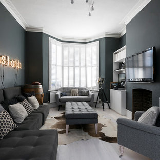 Living room - large transitional open concept living room idea in London with gray walls, a wall-mounted tv and a standard fireplace