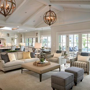 Inspiration for a large country formal and open concept medium tone wood floor and brown floor living room remodel in Phoenix with beige walls, no fireplace and no tv