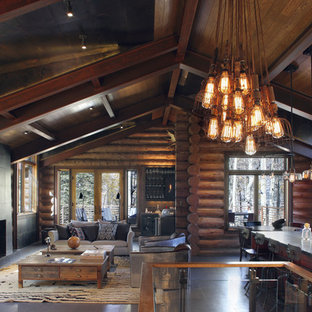 This is an example of a large rustic open plan living room in Denver.