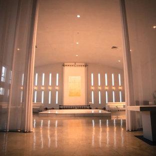 Ispirazione per un grande soggiorno industriale aperto con pareti bianche, pavimento in linoleum, nessun camino, pavimento bianco, sala formale e nessuna TV