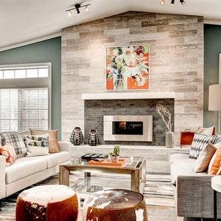 デンバーの大きいコンテンポラリースタイルのおしゃれなLDK (フォーマル、オレンジの壁、カーペット敷き、横長型暖炉、タイルの暖炉まわり、テレビなし、青い床) の写真